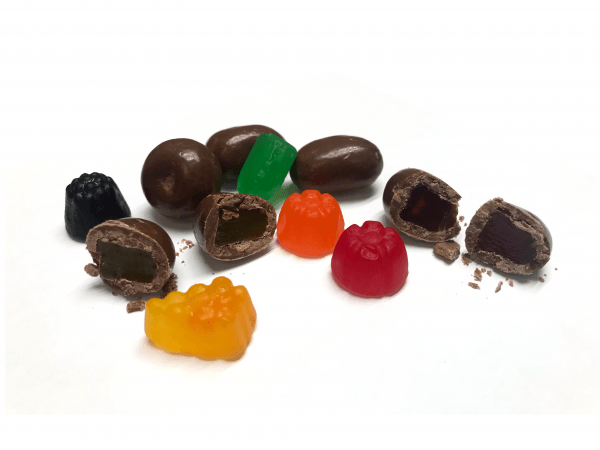 Assorted jujubes coated in milk chocolate